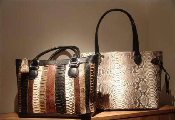 Fragile snake skin handbags