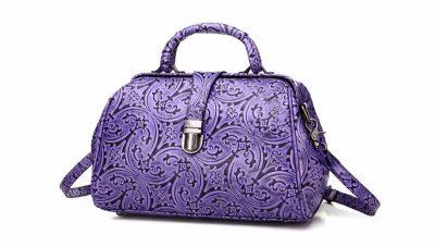Purple embossed leather handbag-Left
